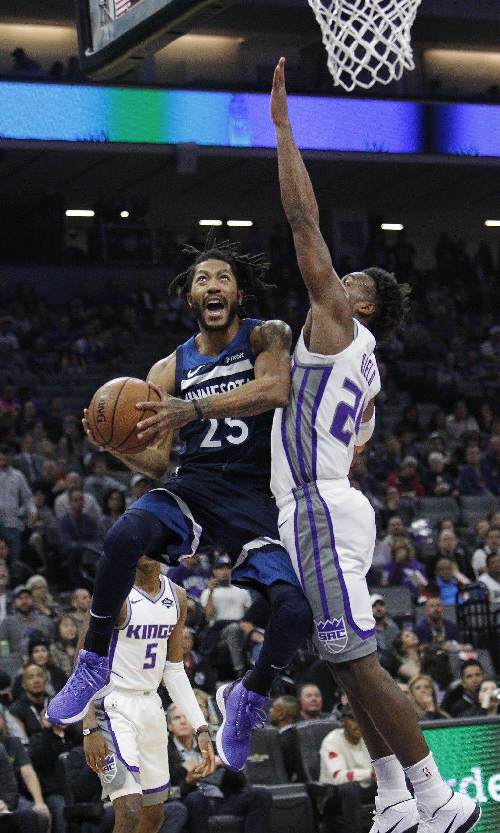 Minnesota Timberwolves guard Derrick Rose (25) drives to the basket against Sacramento Kings guard Buddy Hield (24) during the first half of an NBA ba