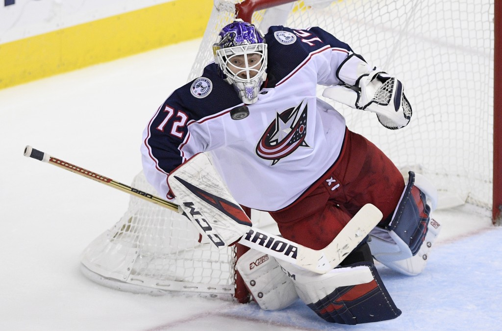 Columbus Blue Jackets goaltender Sergei Bobrovsky (72), of Russia, stops the puck during the third period of an NHL hockey game against the Washington