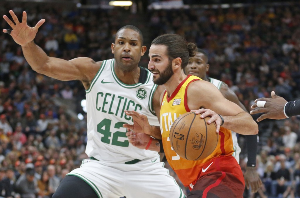 Boston Celtics center Al Horford (42) guards Utah Jazz guard Ricky Rubio (3) as he drives in the first half during an NBA basketball game Friday Nov.
