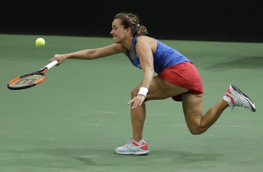 Barbora Strycova of the Czech Republic struggles to return the ball to Sofia Kenin of the United States during their tennis match of the Fed Cup Final