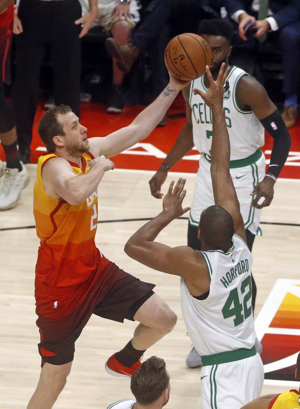 Utah Jazz forward Joe Ingles (2) goes to the basket as Boston Celtics center Al Horford (42) defends in the first half during an NBA basketball game F