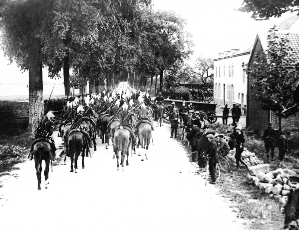 FILE - Lancers on horseback enter a Belgium village in the first days of the war on the Western Front in a 1914 photo. They were messengers, spies, se