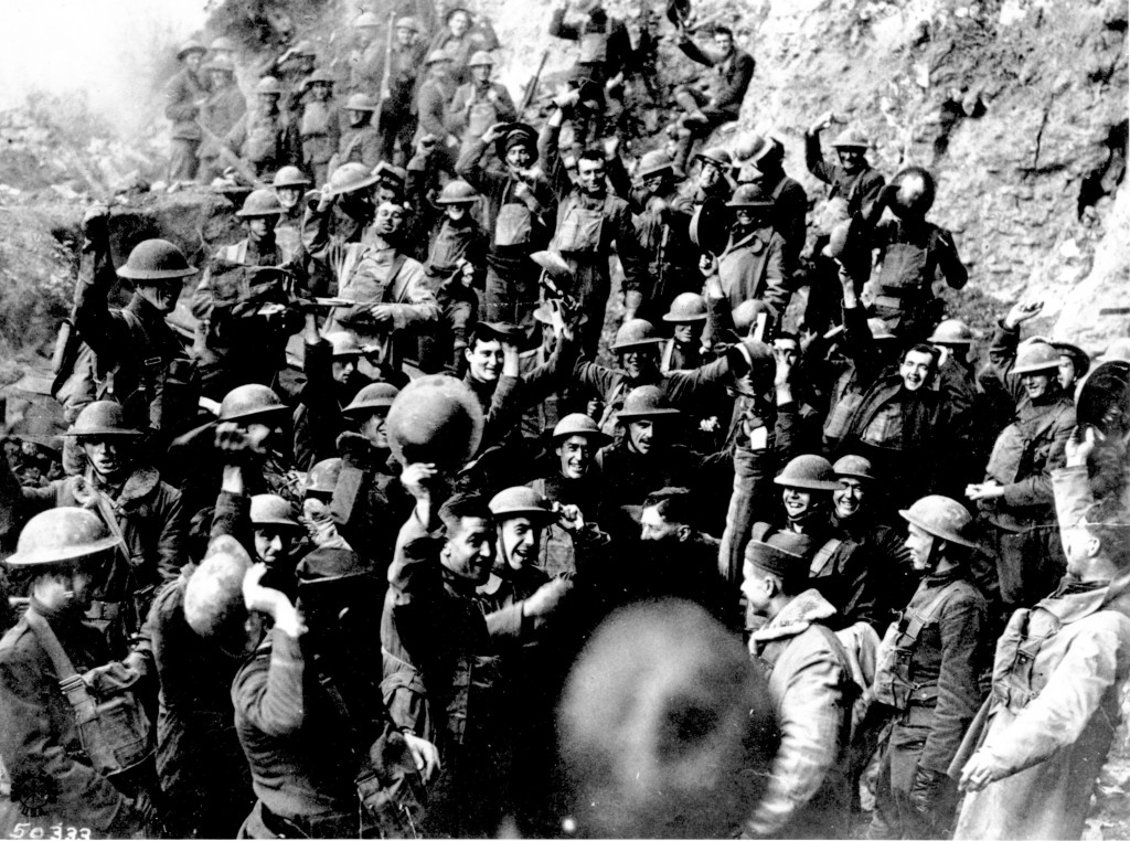 FILE In this Nov. 11, 1918 file photo, American troops cheer after hearing the news that the Armistice had been signed, ending World War I. At 11 a.m.