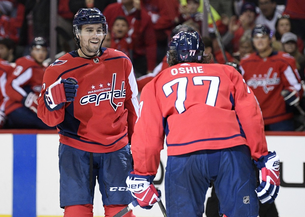 Washington Capitals defenseman Matt Niskanen, left, celebrates his goal with right wing T.J. Oshie (77) during the second period of an NHL hockey game