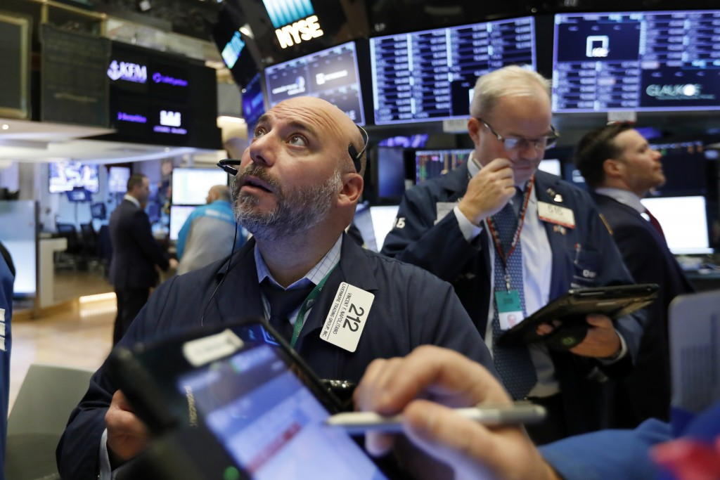 Trader Vincent Napolitano, left, works on the floor of the New York Stock Exchange, Friday, Nov. 9, 2018. Stocks are falling as energy companies are d