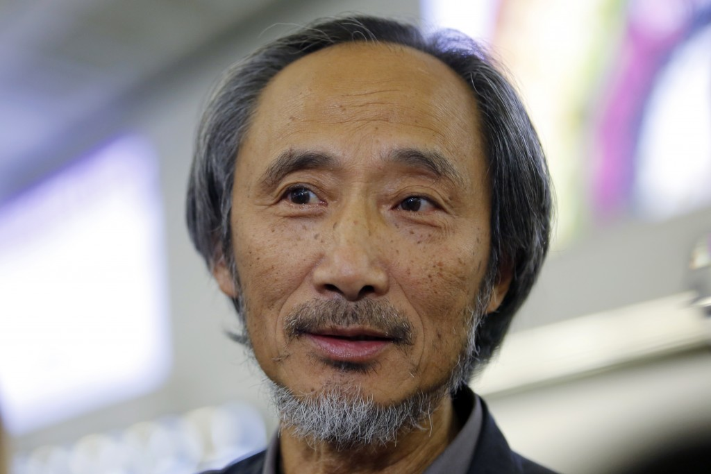 In this Nov. 9, 2018, photo, Chinese dissident writer Ma Jian speaks to media after arriving Hong Kong international airport. Concerns have been raise