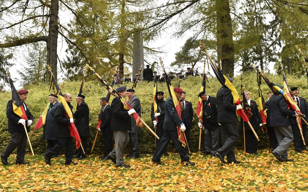 Flag bearers prepare to attend a World War I Centenary service at the St. Symphorien cemetery in Mons, Belgium, Saturday, Nov. 10, 2018. The cemetery