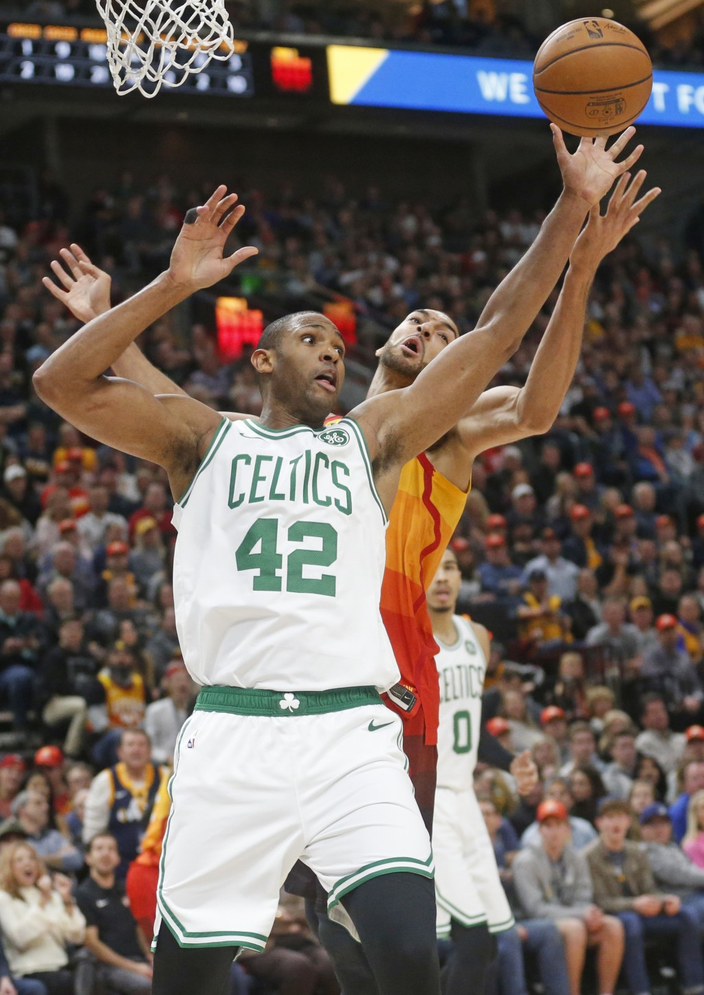 Boston Celtics center Al Horford (42) and Utah Jazz center Rudy Gobert, rear, battle for a loose ball in the first half during an NBA basketball game