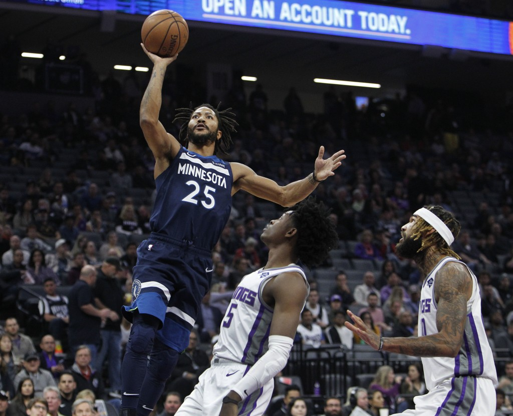 Minnesota Timberwolves guard Derrick Rose (25) shoots over Sacramento Kings guard De'Aaron Fox (5) during the first half of an NBA basketball game in