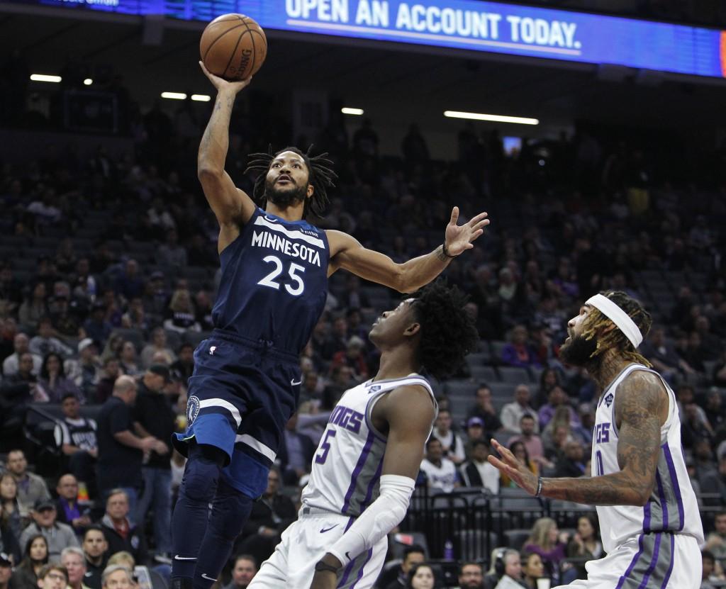 Minnesota Timberwolves guard Derrick Rose (25) shoots over Sacramento Kings guard De'Aaron Fox (5) during the first half of an NBA basketball game in