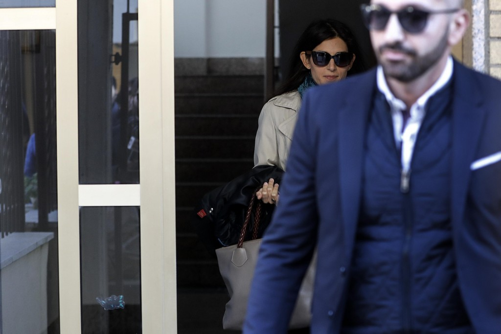 Rome mayor Virginia Raggi leaves her house, in Rome, Saturday, Nov. 10, 2018. A verdict is expected within hours for Rome's mayor, on trial in the Ita