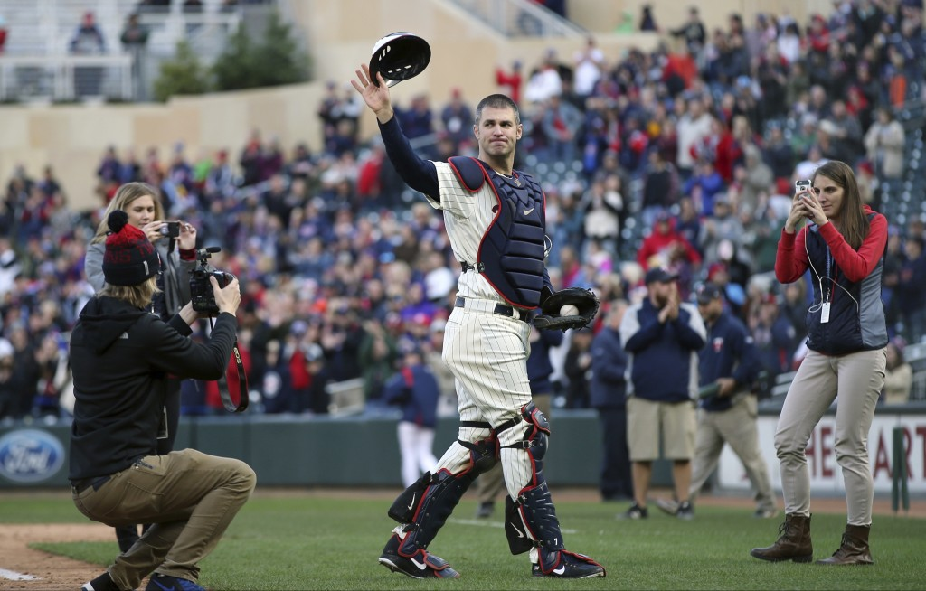 FILE - In this Sunday, Sept. 30, 2018, file photo, Minnesota Twins' Joe Mauer dons catcher's gear to catch for a pitch against a Chicago White Sox bat