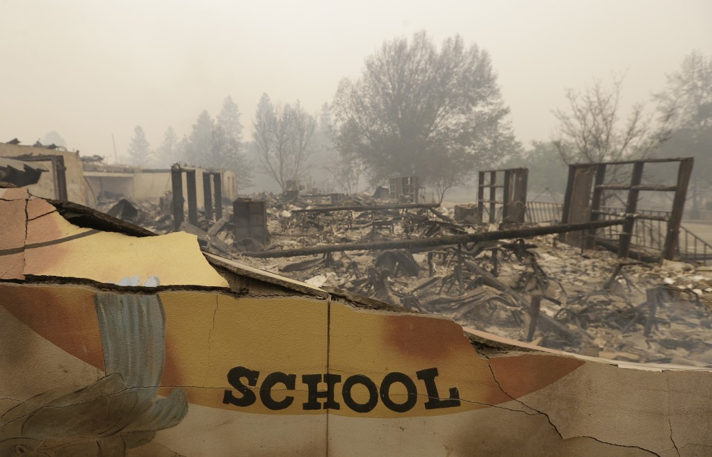The burned remains of the Paradise Elementary school is seen Friday, Nov. 9, 2018, in Paradise, Calif. Blocks and blocks of homes and businesses in th