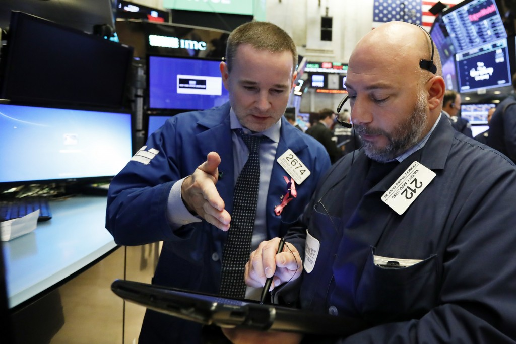 Specialist Stephen Naughton, left, and trader Vincent Napolitano work on the floor of the New York Stock Exchange, Friday, Nov. 9, 2018. Stocks are fa