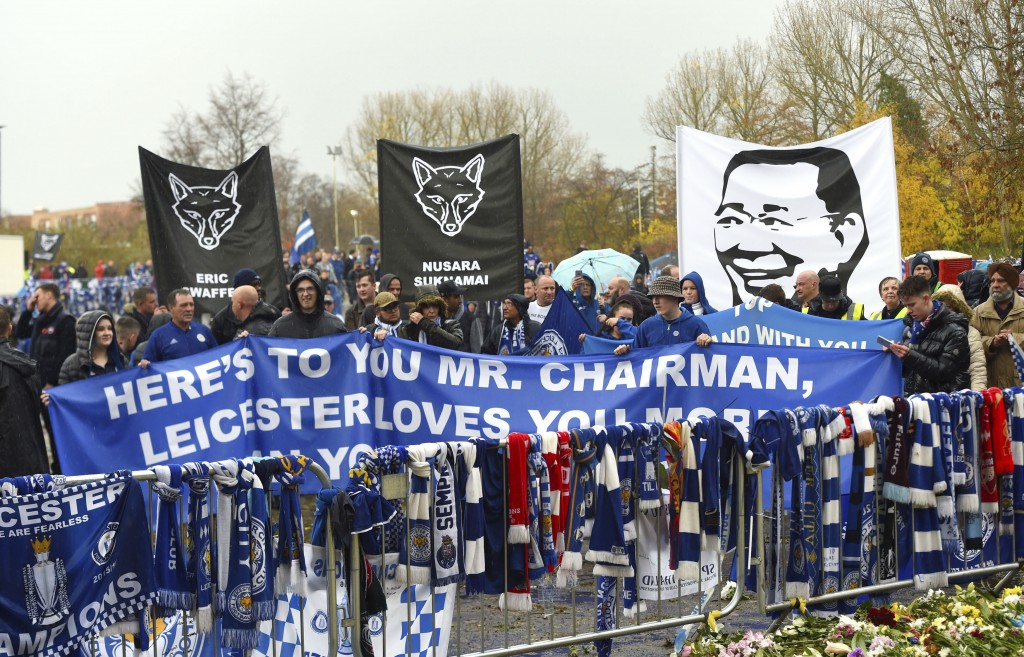 Fans on a memorial walk for those who lost their lives in the Leicester City helicopter crach including Leicester City Chairman Vichai Srivaddhanaprab