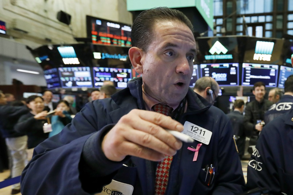 Trader Tommy Kalikas works on the floor of the New York Stock Exchange, Friday, Nov. 9, 2018. Stocks are falling as energy companies are dragged lower