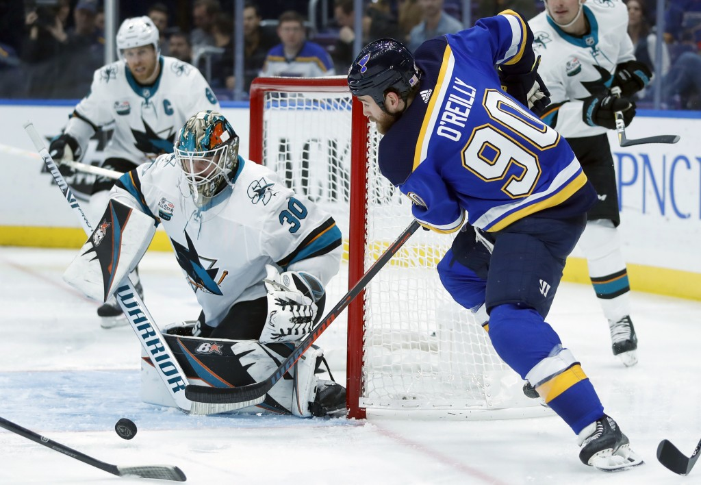 St. Louis Blues' Ryan O'Reilly (90) tries to get off a shot as San Jose Sharks goaltender Aaron Dell (30) defends during the second period of an NHL h