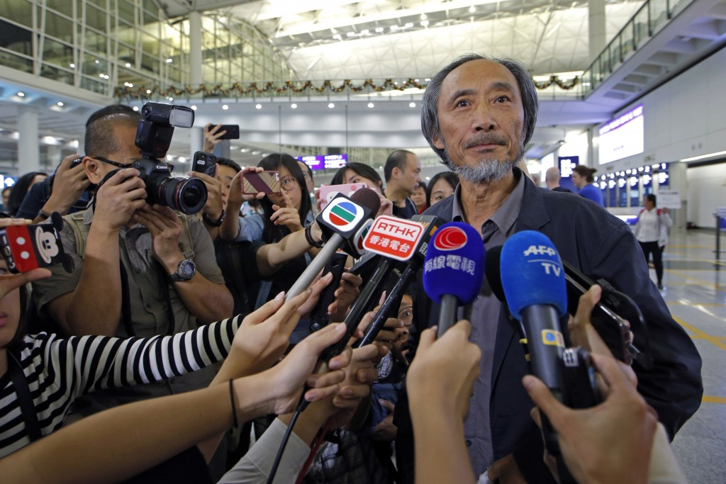 In this Nov. 9, 2018, photo, Chinese dissident writer Ma Jian speaks to media after arriving Hong Kong international airport.  Concerns have been rais