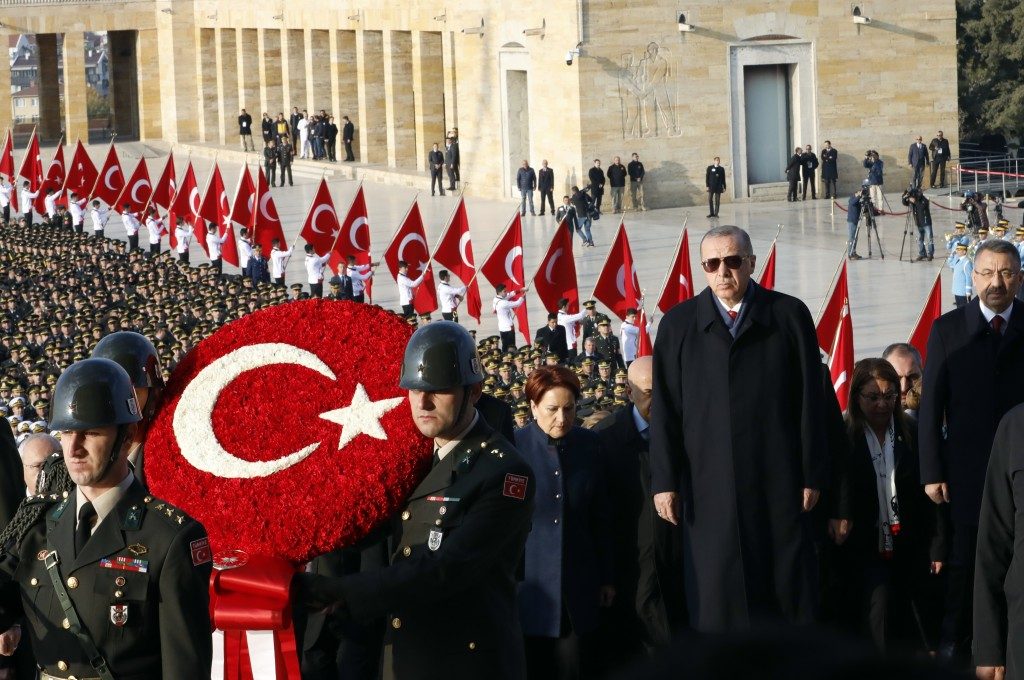 Turkey's President Recep Tayyip Erdogan, front right, attends a wreath-laying ceremony at the mausoleum of the nation's founding father Mustafa Kemal