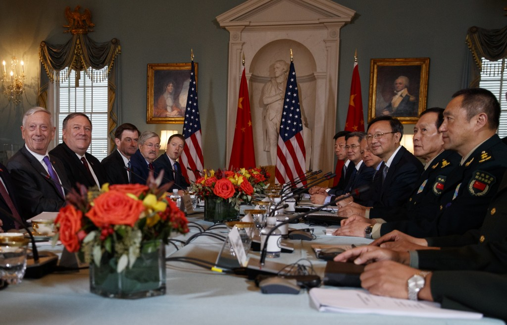 Secretary of Defense Jim Mattis, left, Secretary of State Mike Pompeo, second from left, Chinese Politburo Member Yang Jiechi, third from right, and C