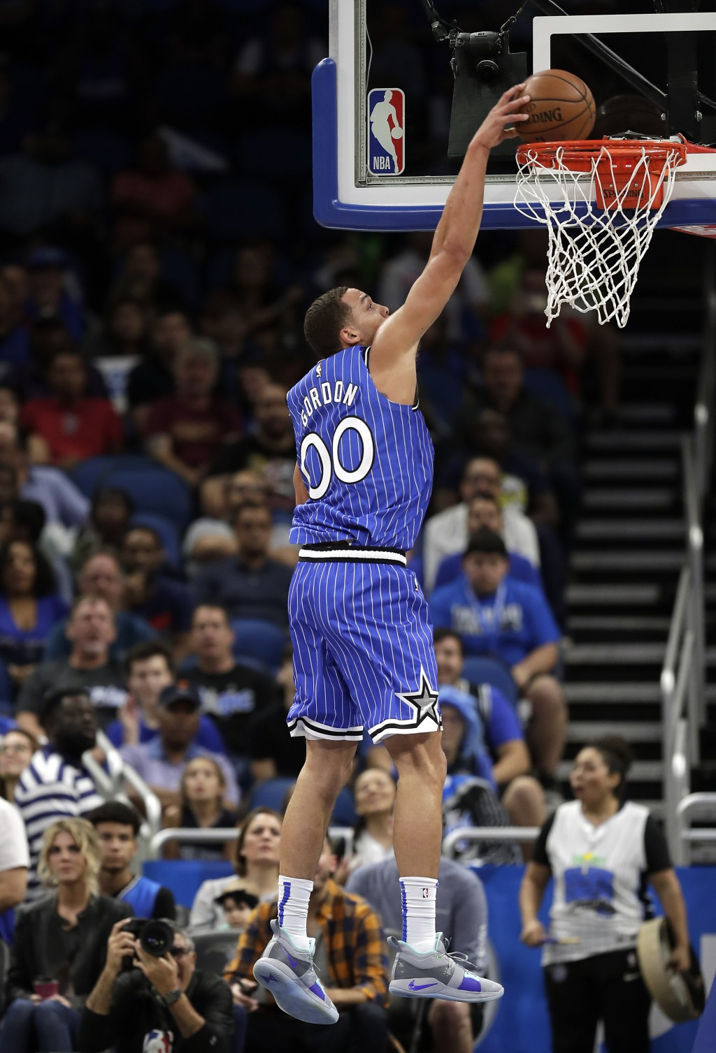 Orlando Magic's Aaron Gordon (00) makes an uncontested dunk against the Washington Wizards during the first half of an NBA basketball game, Friday, No