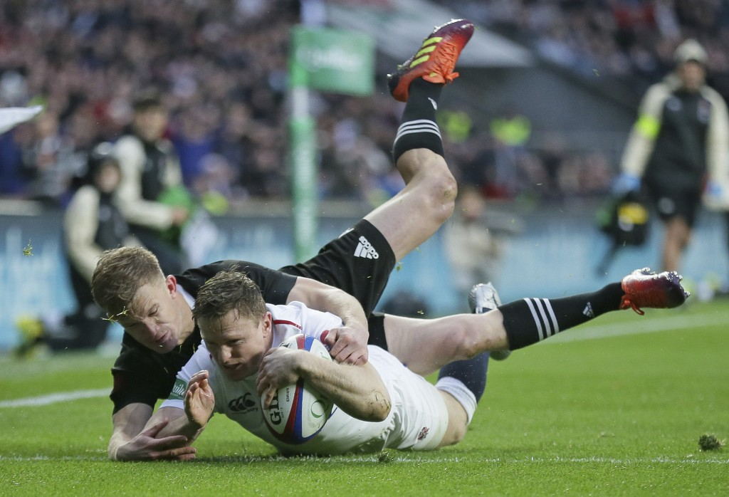 England's Chris Ashton scores a try during the rugby union international match between England and New Zealand at Twickenham stadium in London, Saturd