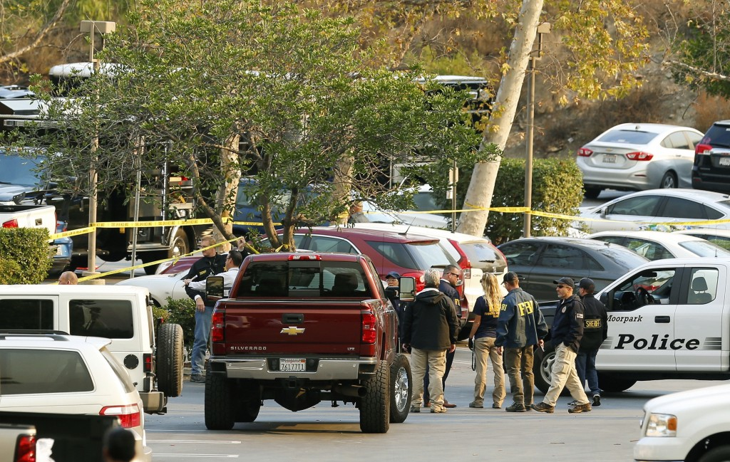 FBI investigators join law enforcement as they work near the scene of Wednesday's shooting in Thousand Oaks, Calif., Friday, Nov. 9, 2018. Investigato