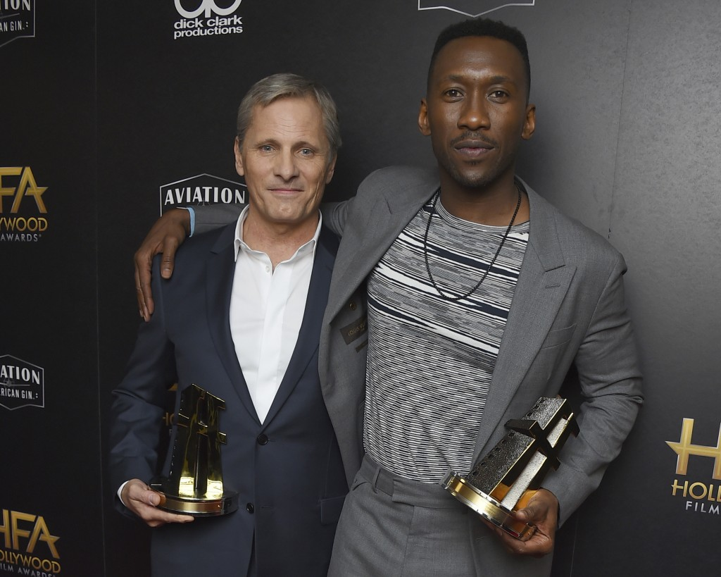 "FILE - In this Nov. 4, 2018 file photo, Viggo Mortensen, left, and Mahershala Ali, winners of the ensemble award for ""Green Book,"" pose in the press r"