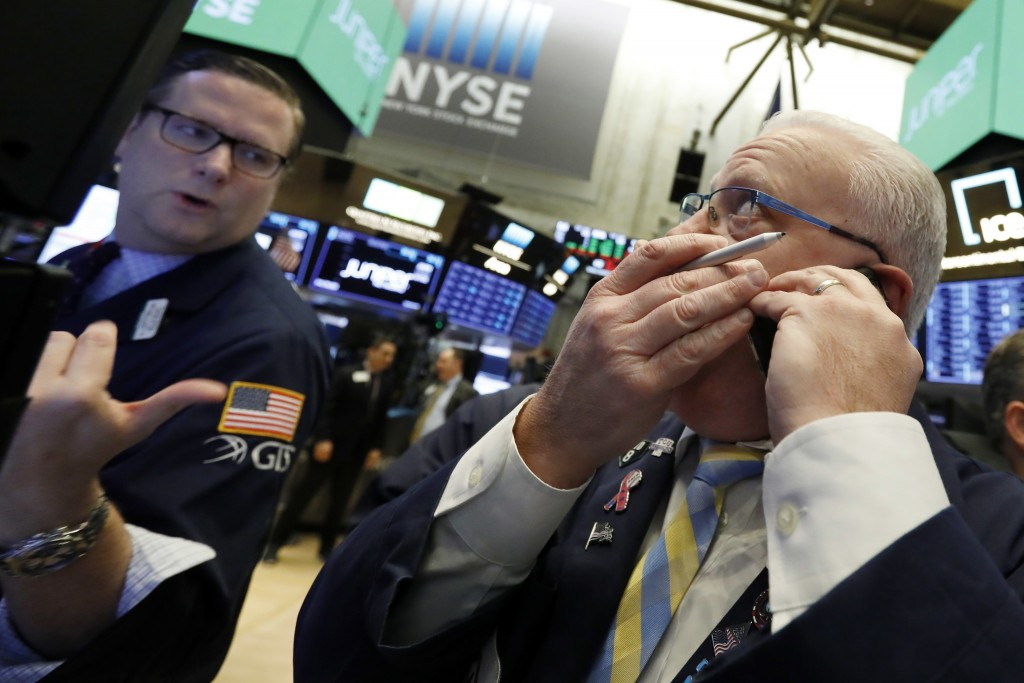Trader Thomas Ferrigno, right, and specialist Gregg Maloney work on the floor of the New York Stock Exchange, Friday, Nov. 9, 2018. Stocks are falling