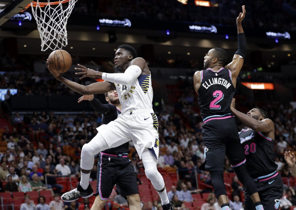 Indiana Pacers guard Victor Oladipo (4) drives past Miami Heat guard Wayne Ellington (2) during the first half of an NBA basketball game Friday, Nov.