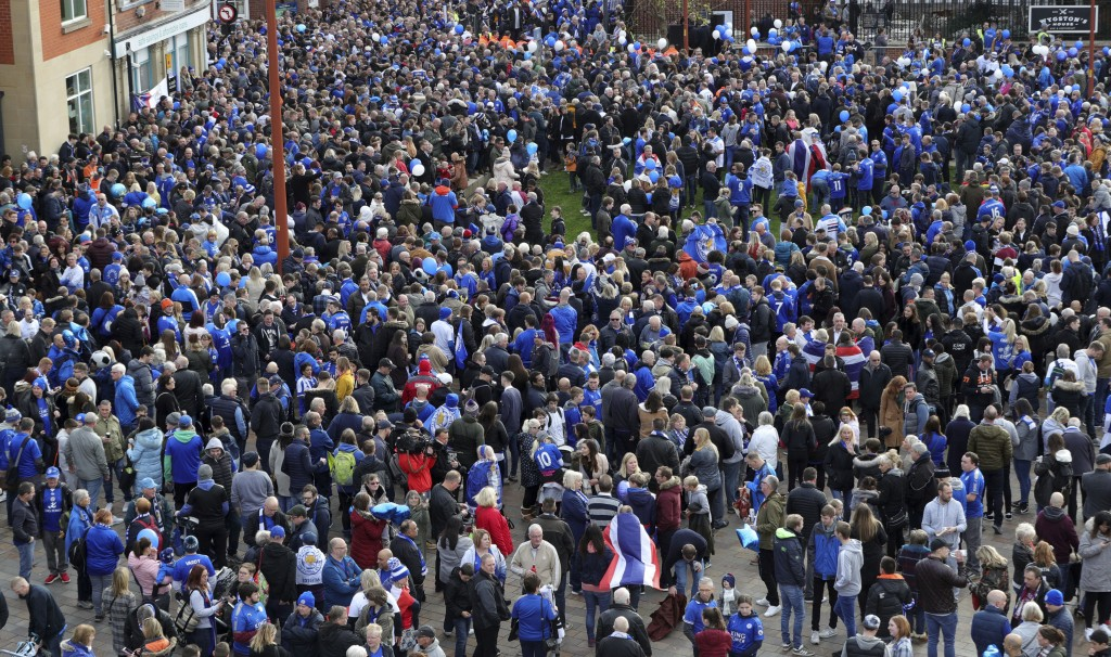 Leicester City fans gather at Jubilee Square in Leicester, before taking part in a memorial walk to the King Power Stadium, in honour of the club's ow