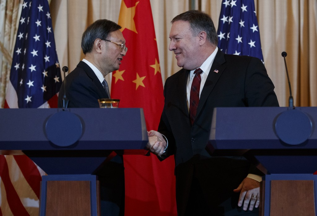 Secretary of State Mike Pompeo, right, shakes hands with Chinese Politburo Member Yang Jiechi at the conclusion of a news conference at the State Depa...