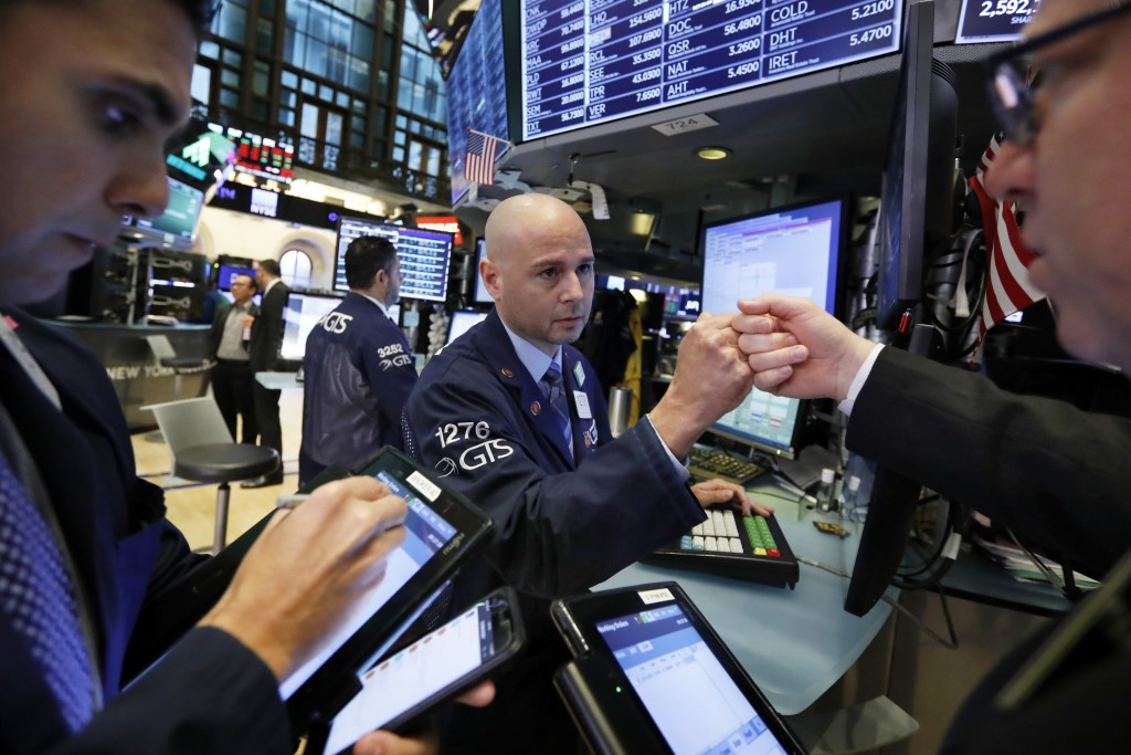 Specialist Mario Picone, center, works with traders at his post on the floor of the New York Stock Exchange, Friday, Nov. 9, 2018. Stocks are falling