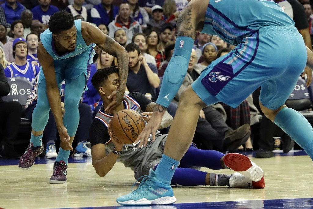 Philadelphia 76ers' Markelle Fultz, center, tries to pass as Charlotte Hornets' Malik Monk, left, and Willy Hernangomez defend during the second half