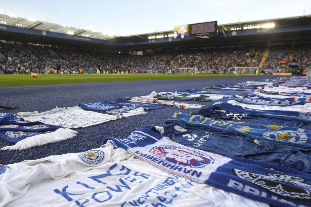 Tributes from other football clubs and fans surround the pitch ahead of the Premier League match at the King Power Stadium, Leicester. Saturday Nov. 1