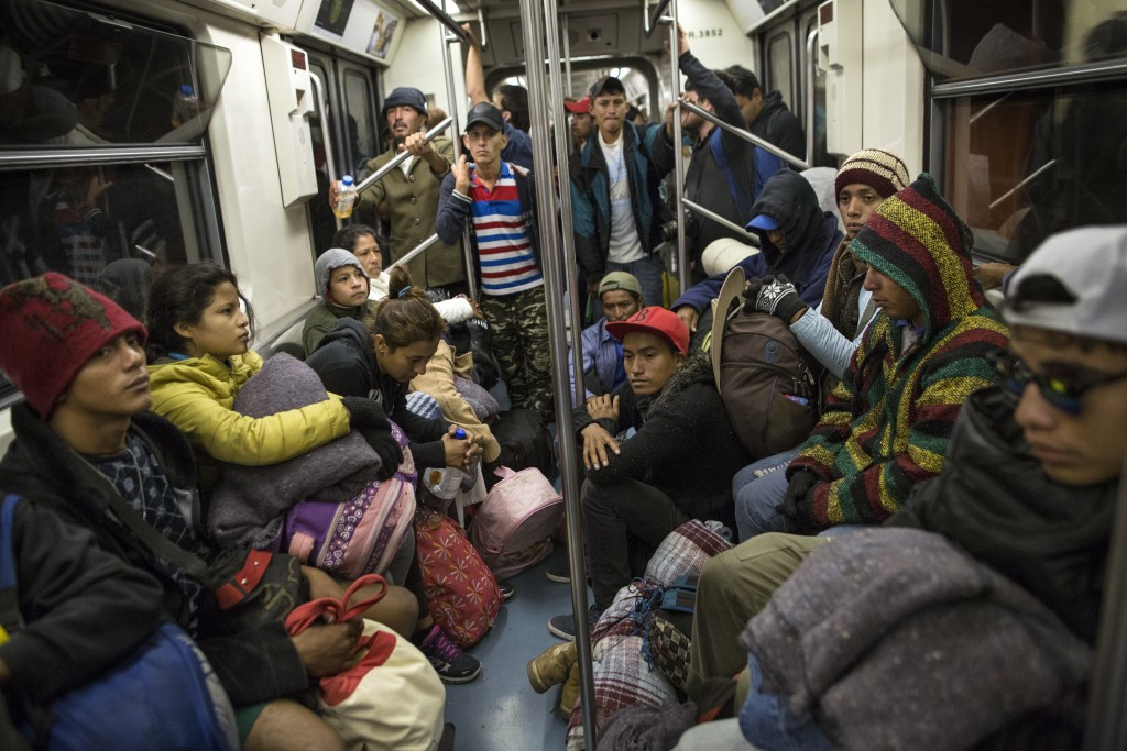 Central American migrants ride on the subway after leaving the temporary shelter at the Jesus Martinez stadium, in Mexico City, Friday, Nov. 9, 2018.