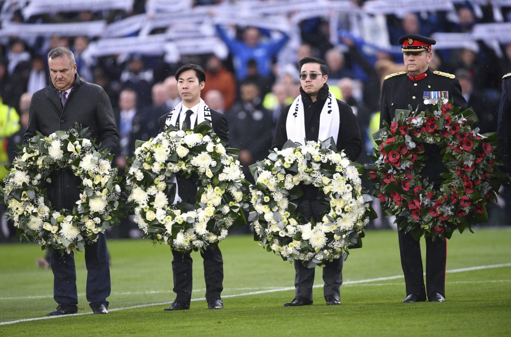 Aiyawatt Srivaddhanaprabha, second right, lays a wreath for Armistice Day and those who lost their lives in the Leicester City helicopter crash includ