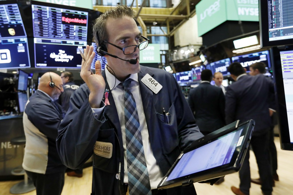 Trader Gregory Rowe works on the floor of the New York Stock Exchange, Friday, Nov. 9, 2018. Stocks are falling as energy companies are dragged lower