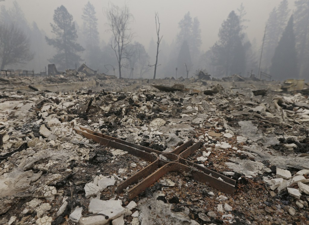 A cross is among the rubble of the Our Savior Lutheran Church Friday, Nov. 9, 2018, in Paradise, Calif. The church was destroyed by a wildfire that sw