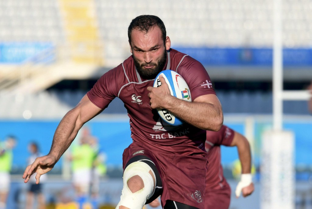 Georgia's Tamaz Mchedlidze runs with the ball is on his way to score a try during an international test match between Italy and Georgia, at the Artemi
