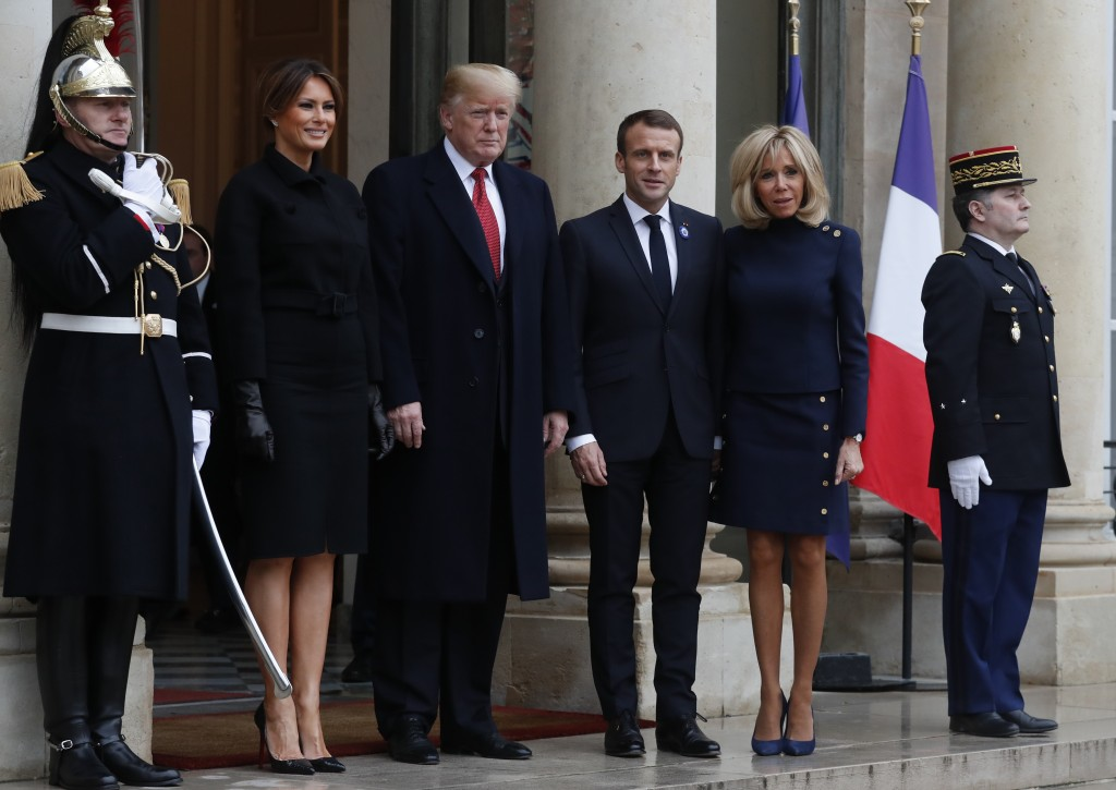 French President Emmanuel Macron, third right, his wife Brigitte, U.S President Donald Trump, and first lady Melania Trump, second left, pose outside