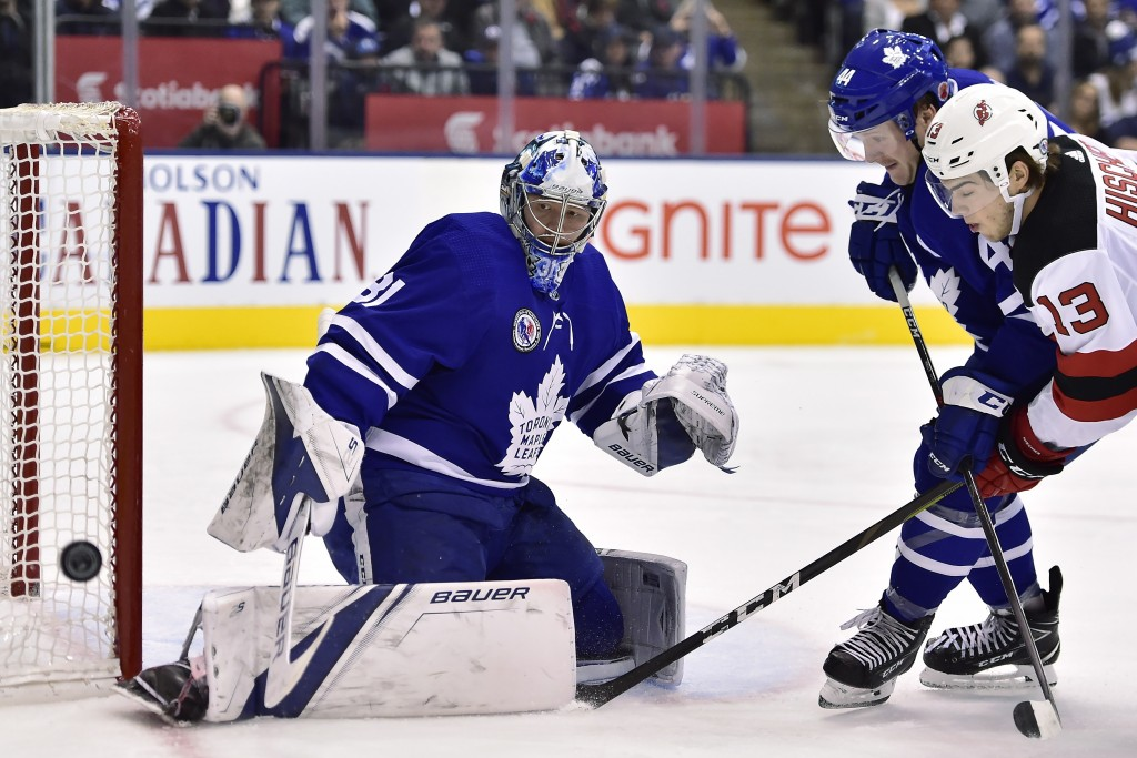 New Jersey Devils center Nico Hischier (13) fails to score past Toronto Maple Leafs goaltender Frederik Andersen (31) as Toronto's Morgan Rielly (44)