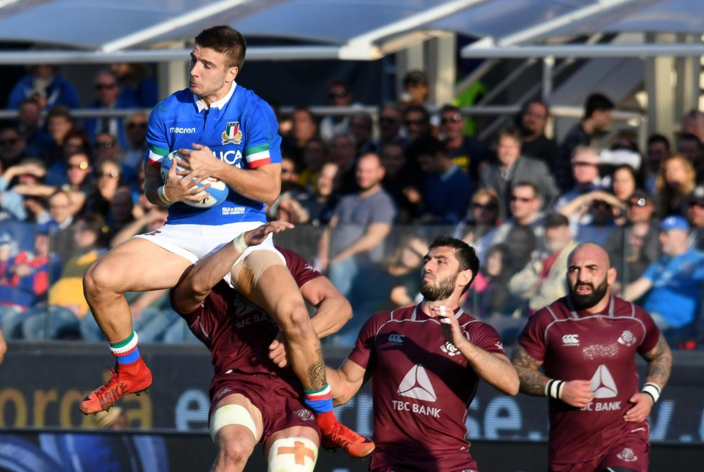 Italy's Luca Sperandio, left, jumps for the ball during an international test match between Italy and Georgia, at the Artemio Franchi stadium in Flore