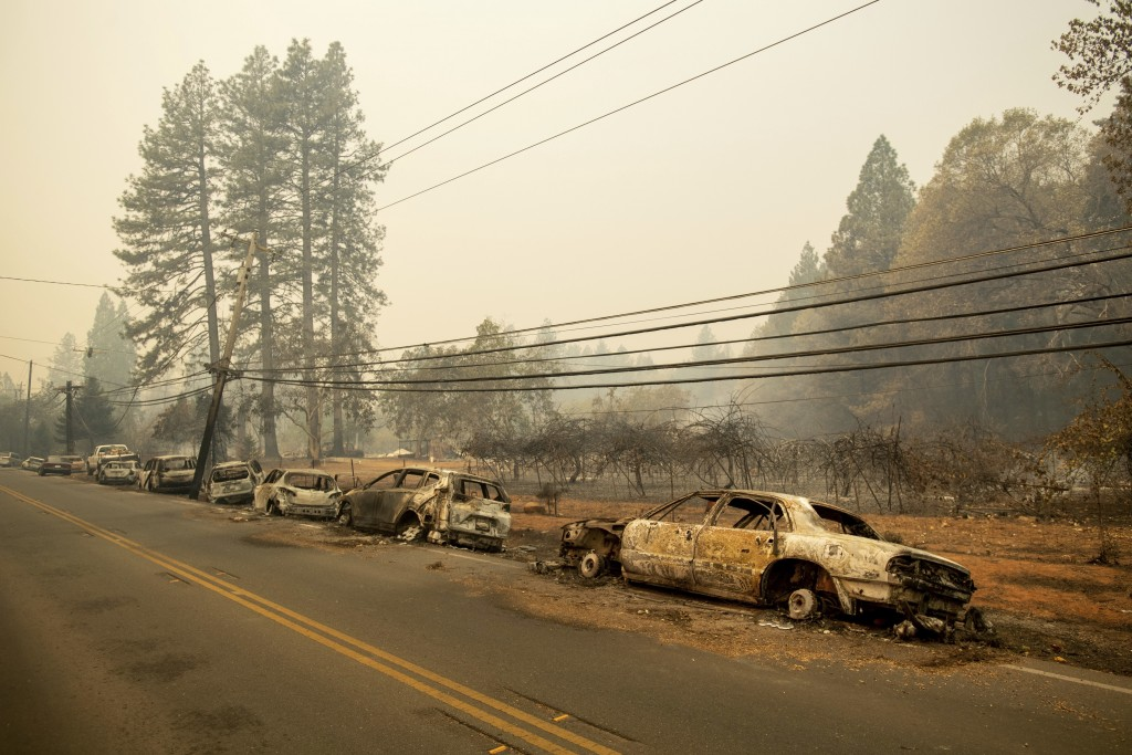 Abandoned vehicles line Skyway after a wildfire burned through Paradise, Calif., on Friday, Nov. 9, 2018. (AP Photo/Noah Berger)