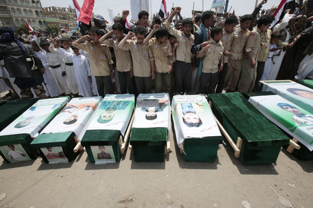 FILE - In this Aug. 13, 2018 file photo, Yemenis attend the funeral of victims of a Saudi-led airstrike, in Saada, Yemen. Airstrikes by Saudi Arabia a