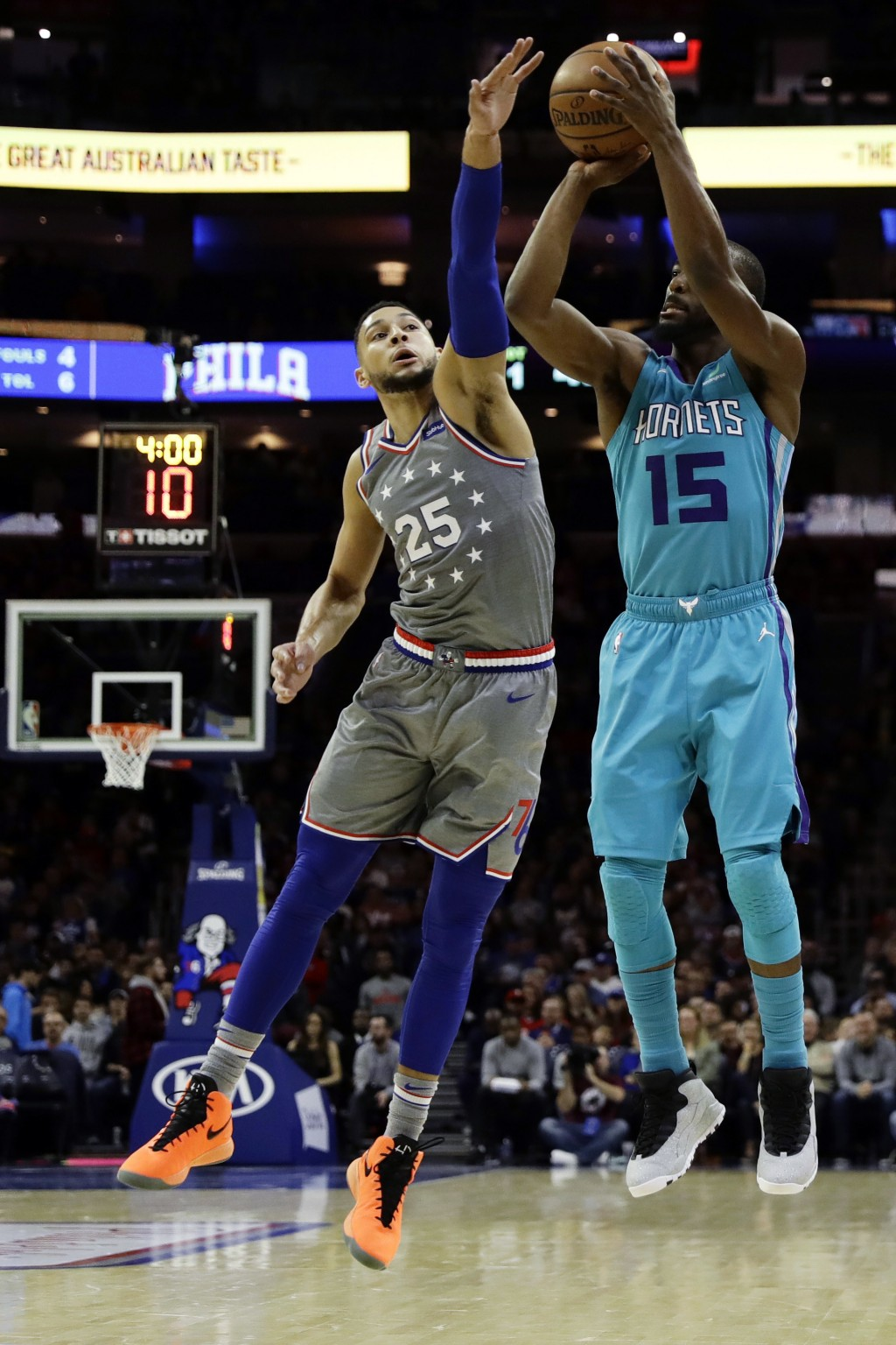 Charlotte Hornets' Kemba Walker (15) goes up for a shot against Philadelphia 76ers' Ben Simmons (25) during the first half of an NBA basketball game,
