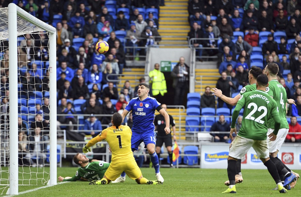 Cardiff City's Callum Paterson (left) has a shot saved by Brighton & Hove Albion goalkeeper Mathew Ryan during the English Premier League soccer match