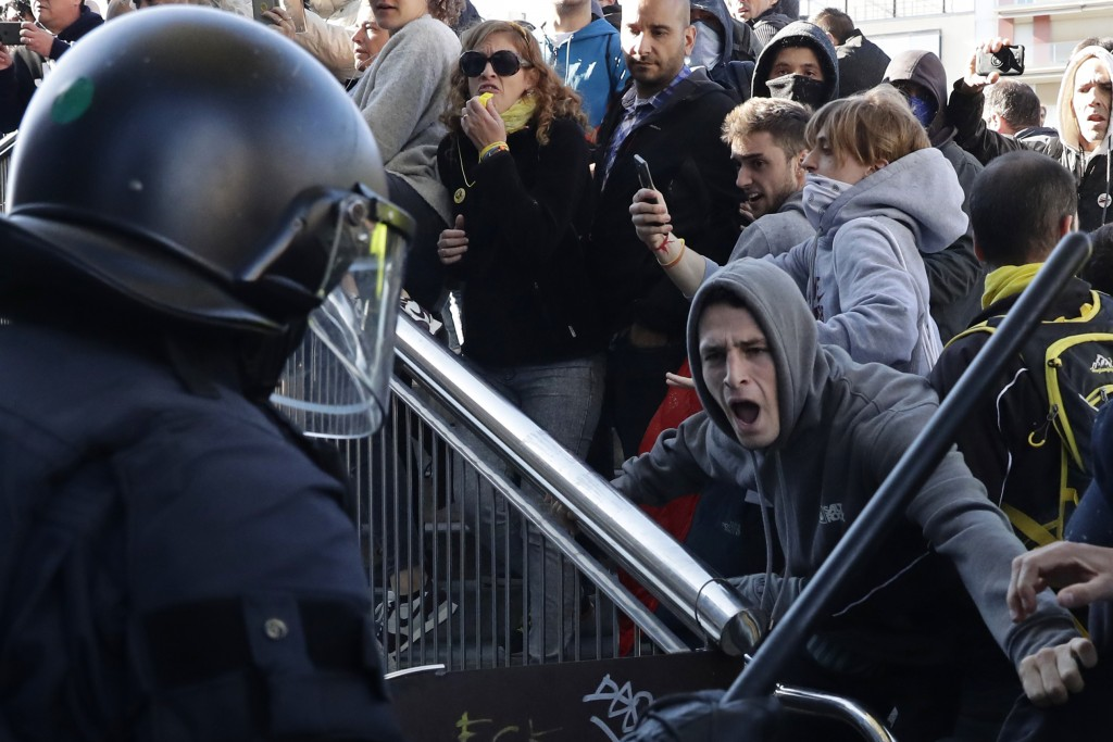 Police react with protesters during a demonstration by CDR (Committees for the Defense of the Republic) in Barcelona, Spain, Saturday, Nov. 10, 2018.
