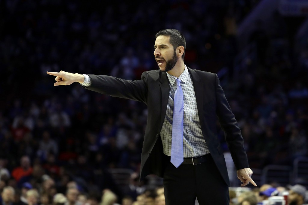 Charlotte Hornets head coach James Borrego yells to his team during the first half of an NBA basketball game against the Philadelphia 76ers, Friday, N