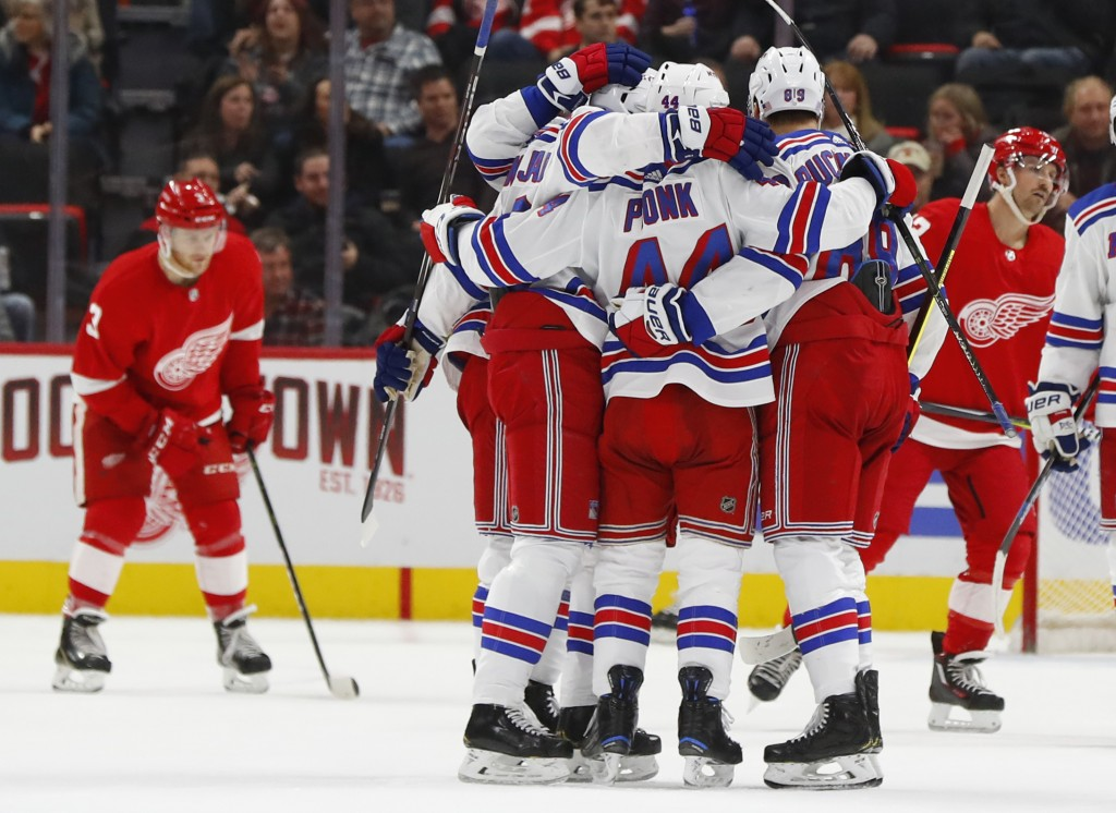 New York Rangers' Neal Pionk (44) celebrates his goal against the Detroit Red Wings in the second period of an NHL hockey game in Detroit, Friday, Nov